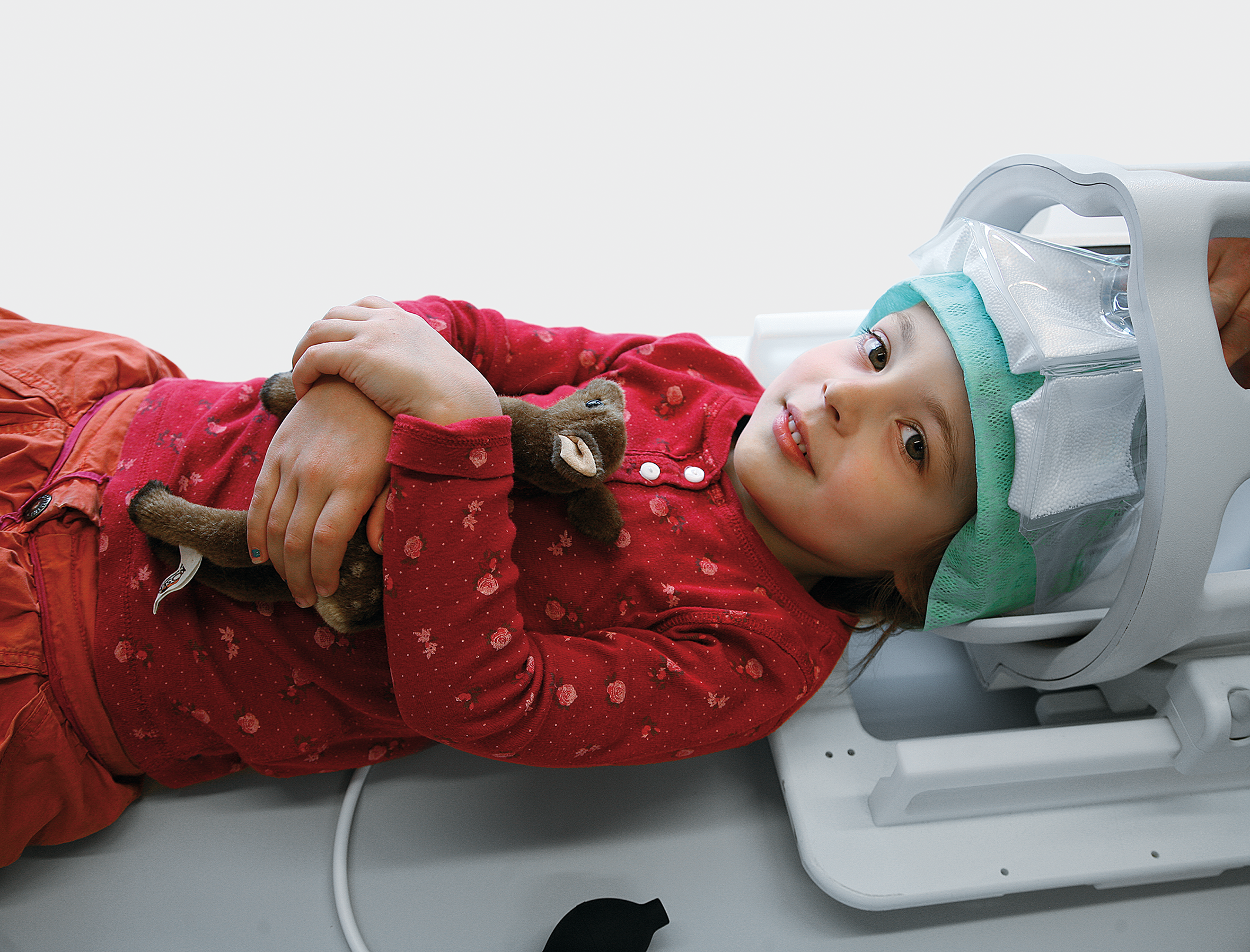 Child in MRI headcoil with Crania positioning aid